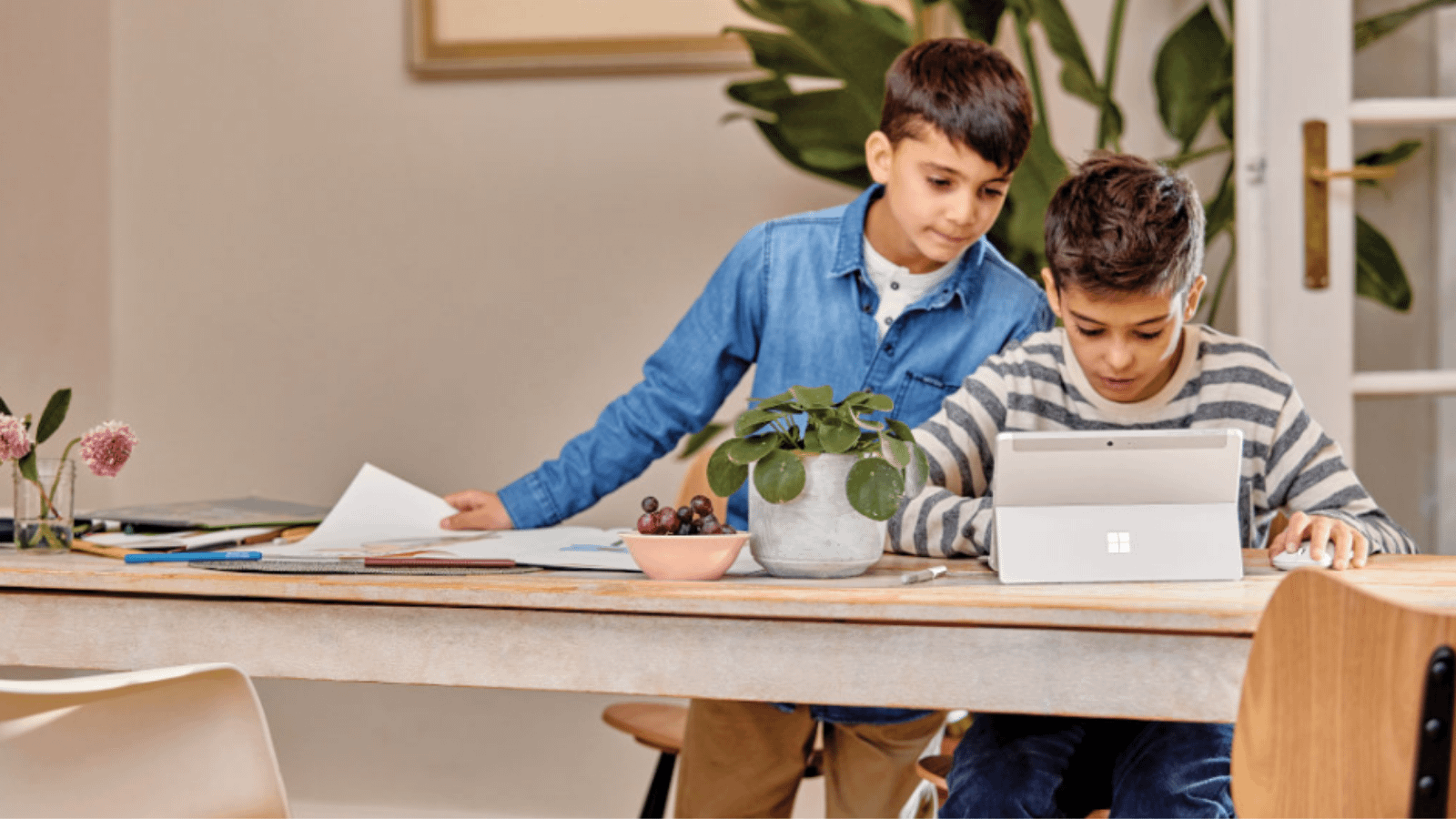 Two boys collaborating on a school project